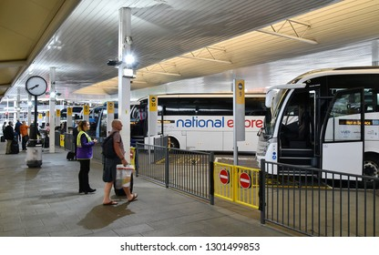 London Heathrow Airport, UK - June 5, 2017: National Express coaches sit parked in Heathow Airport's Central Bus Terminal. The bus station is open 24 hours a day serving terminals 1 through to 5.