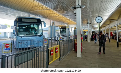 London Heathrow Airport, UK - May 20, 2018: Coaches sit parked in Heathow Airport's Central Bus Terminal. The bus station is open 24 hours a day serving terminals 1 through to 5.