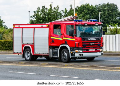 LONDON, HEATHROW / UK - 15 JULY 2014: Fire fighting engine vehicle Scania responding and drive to the fire