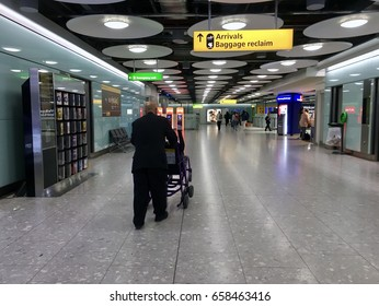 London Heathrow, UK - 30th April 2017: Arrival lounge at London Heathrow airport terminal, a passenger walking past immigration to baggage reclaim.