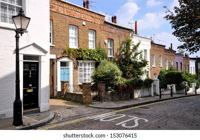 London hill of terraced cottages, without parked cars,