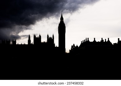London - The Houses of Parliament and the Big Ben silhouetted under thick dark clouds