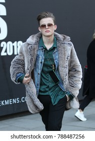 LONDON - JAN 7, 2018: Guest showing street style at London Fashion Week Men's Fall Winter 2018