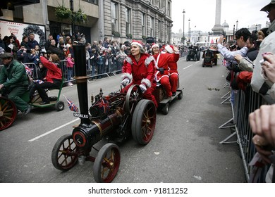 LONDON - JANUARY 01: Performers on small trains take part in the New Years Day Parade on January 01, 2012 in London, UK. More than 10,000 performers represent for 20 countries world-wide.