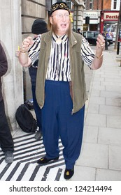 LONDON - JANUARY 10: john mccririck signs autographs outside BBC Radio 2  in London, England, on Wednesday, January 10, 2013