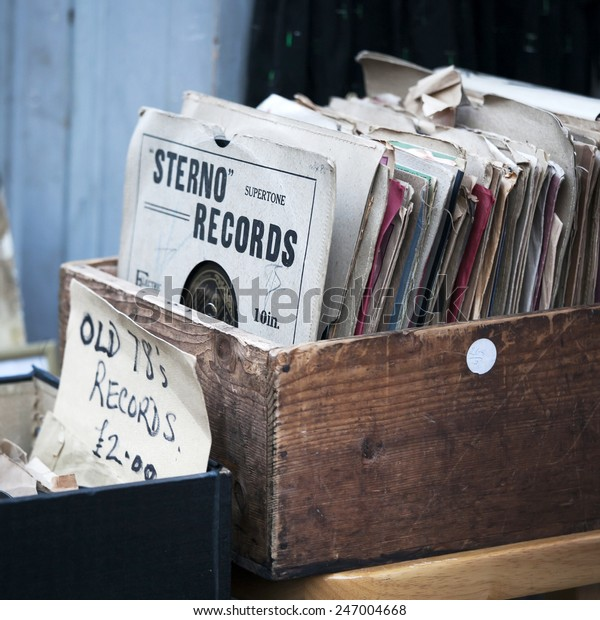 London - January 17, 2015. Flea market window shop with old-fashioned goods displayed in London city, UK, on 13 June 2014. Retro styled image of boxes with vinyl turntable records on a flee market