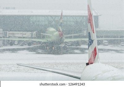 LONDON - JANUARY 18, 2013: Aircrafts in the snowstorm at Heathrow airport on January 18, 2013 in London.Thousands of travelers stuck at Heathrow airport due to the heavy snowing.