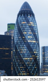 LONDON - JANUARY 18, 2015.  The modern glass buildings of the Swiss Re Building or informally the Gherkin. This tower is 180 meters tall and stands in the City of London Financial District.