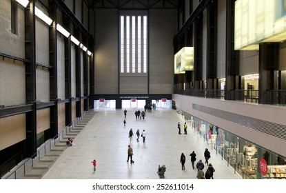 LONDON - JANUARY 18, 2015.People walking in the Turbine Hall in Tate Modern Art Gallery.It is located in the former Bankside Power Station, (a disused power station) in London, South Thames Embankment