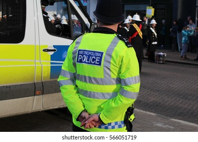 London, January 2017. A Metropolitan Police Officer seen on duty in Battersea, South West London. Their high visibility best shows the force's world famous logo.