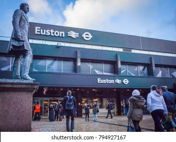LONDON- JANUARY, 2018: Euston Station. Large railway terminus connected to the National Rail Network and London Underground.  Exterior view of passengers walking in to main entrance.