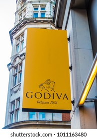 London, January, 2018. A front external view of the sign above the  Godiva store on Kensington High Street, in Kensington.