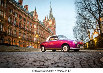 LONDON- JANUARY, 2018: Pink car parked in front of the iconic London St Pancras International railway station