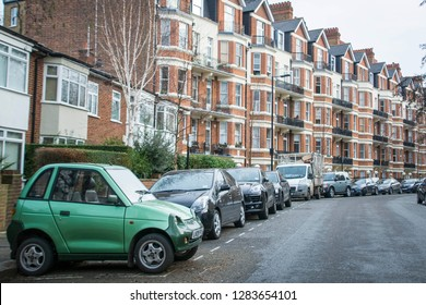 LONDON- JANUARY, 2019: A small electric car parked on upmarket residential street in north west London