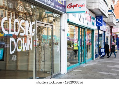 LONDON- JANUARY, 2019: A vacant high street shop with 'closing down' sign in shop window