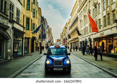 LONDON- JANUARY, 2020:  A London taxi cab on Bond Street, an upmarket West End street famous for its designer and luxury shops