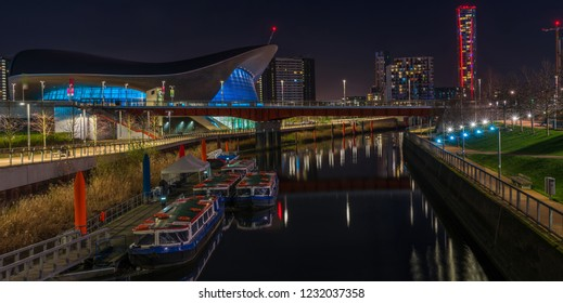 LONDON - January 20th 2017: Night view of The Aquatics Center in Queen Elizabeth Olympic Park. The building was designed by Zaha Hadid Architects and now open to the public in Stratford, London, UK