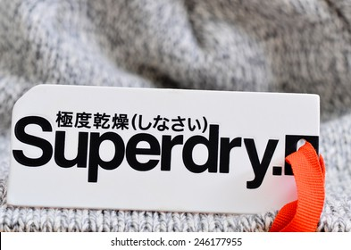 LONDON - JANUARY 22: Superdry clothing label on a woollen garment. January 22, 2015 in London, UK.
