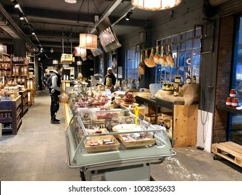 LONDON - JANUARY 23, 2018: Deli meats, cheese and other Italian food products at The Food Market section of Mercato Metropolitano in Elephant & Castle, South London, UK.
