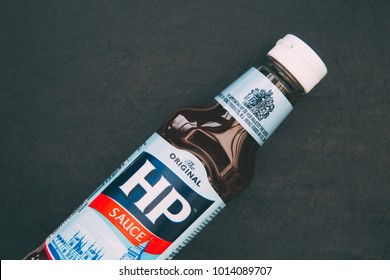 LONDON - JANUARY 29, 2018: HP brown sauce in plastic bottle with logo on dark background