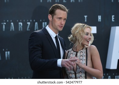 LONDON - JUL 05, 2016: Margot Robbie and Alexander Skarsgard attend the European premiere of The Legend Of Tarzan at Odeon Leicester Square on Jul 5, 2016 in London