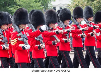 LONDON - JUL 1, 2015: British Royal guards performing the Changing of the Guard at Buckingham Palace. The ceremony is one of the top attractions in London and UK military traditions.