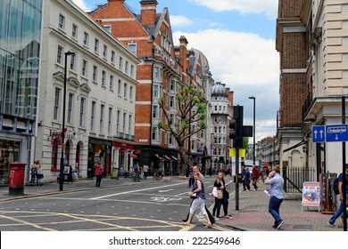 LONDON - JULY 1, 2014: Bloomsbery street in central London in Bloomsbury area. It was developed by the Russell family in the 17th and 18th centuries into a fashionable residential area.