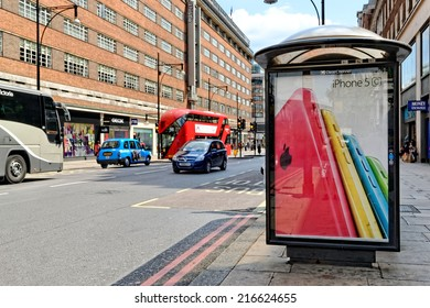 LONDON - JULY 1, 2014. Bus shelter with an advert of iPhone 5C on Oxford street, London. Oxford street is one of the busiest shopping places in the world.