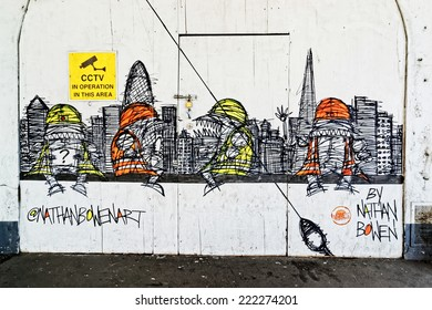 LONDON - JULY 1, 2014. New street art piece on a construction site wall in the City of Londo by Nathan Bowen - a creative street artist from London.