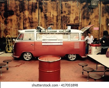 LONDON - JULY 12, 2015: Bob's Lobster uses a vintage Volkswagen bus as their food truck as they prepare for the lunch rush. Just off of Liverpool Street in Shoreditch, East London.