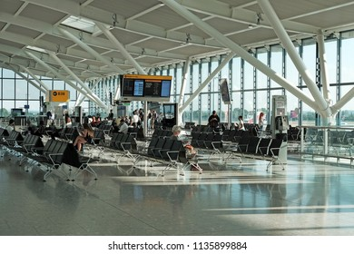 LONDON - JULY 12, 2018: Passengers at the departure lounge in Terminal 5, Heathrow Airport, London. Heathrow is the main airport serving London.