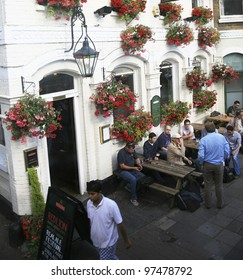 LONDON - JULY 16: Exterior of pub, for drinking and socializing, focal point of the community, on July 16, 2010, London, UK. Pub business, now about 53,500 pubs in UK, has been declining every year