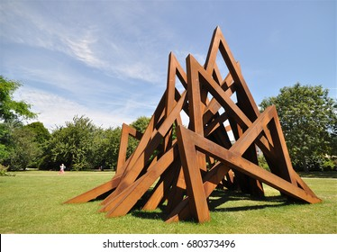 LONDON - JULY 17, 2017. The English Gardens in Regent's Park with a Corten steel installation by Bernar Venet titled 17 Acute Unequal Angles, in London, UK.