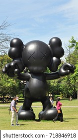 LONDON - JULY 17, 2017. The English Gardens in Regent's Park with a wooden sculpure by Kaws titled Final Days, in London, UK.