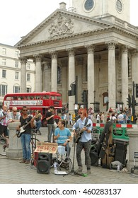 LONDON - JULY 17: Group of musicians called 'The Hod' on the background St Martin-in-the-Fields on Ratha Yatra on Trafalgar Square July 17,2016.