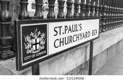 LONDON - JULY 2, 2015: St Paul's Churchyard sign. London road signs have city of London symbol.