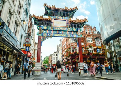 LONDON- JULY, 2018: Crowds of people in London's China Town area of Soho in the west end.