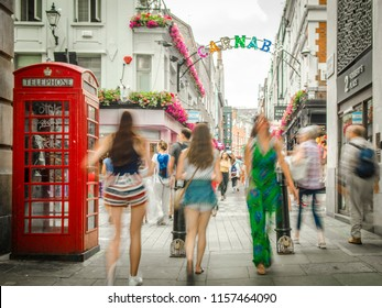 LONDON- JULY, 2018: Shoppers on Carnaby Street, a shopping destination in Londons west end, famous for its fashion and boutique stores