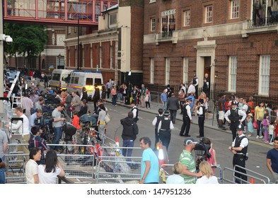LONDON - JULY 23: Well wishers wait to see the new royal baby outside St Mary's Hospital in Paddington, London July 23rd, 2013 in London England.