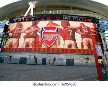 LONDON - JULY 24. One of the 8 murals installed on the exterior of Arsenal FC Emirates Stadium, the Arsenalisation project depicting four Arsenal legends linking arms on Jul 24, 2011, London, England.