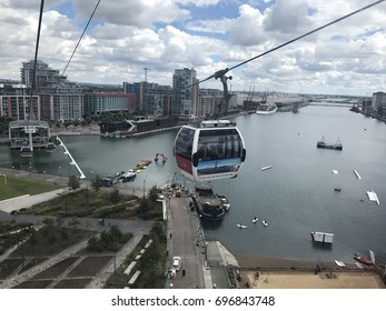LONDON, JULY 28, 2017: Cable cars from Emirates going above Thames river in London.First urban cable car which crosses the Thames from Excel centre to the Emirates Greenwich Peninsula Station