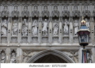London - July 29, 2017: A close-up of the 20th Century martyrs added to the exterior of Westminster Abbey in 1998.