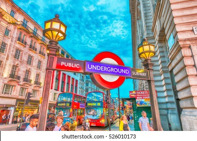 LONDON - JULY 3, 2015: Tourists and locals at Piccadilly subway station entrance. Underground is the preferred way of moving in London.