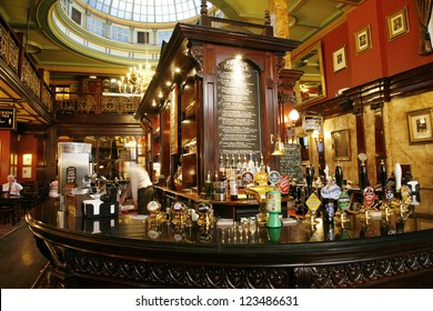 LONDON - JULY 30 : Interior of pub, for drinking and socializing, focal point of community, on July 30, 2012, London, UK. Pub business, now about 53,500 pubs in the UK, has been declining every year