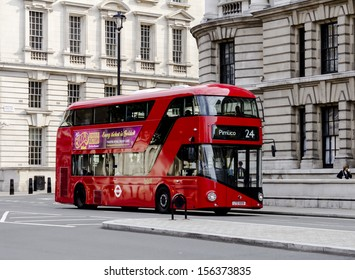 LONDON - JULY 5, 2013: A new London Bus on a road in London on route to Pimlico on July 5 2013