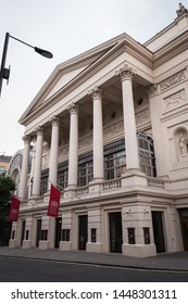 London - July 6th 2014: Vertical view of Royal Opera House facade with no people on a cloudy day