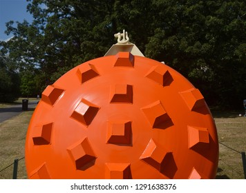 LONDON - JULY 7, 2018.  An orange powder coated steel sculpture by James Capper in the free public English Gardens, north London, UK.