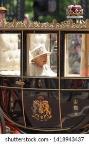 LONDON - JUN 08, 2019: Queen Elizabeth II rides in a carriage during the Trooping the Colour Queen's birthday parade in central London