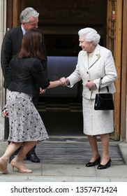 LONDON - JUN 10, 2013: Queen Elizabeth ll leaving hospital after visiting Prince Philip, the Duke of Edinburgh on his birthday