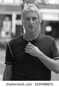 LONDON - JUN 11, 2014: ( Image digitally altered to monochrome ) Paul Weller seen leaving the BBC radio two studio